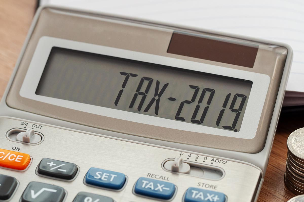 CPAs are tax eperts - picture with a calculator saying tax 2019