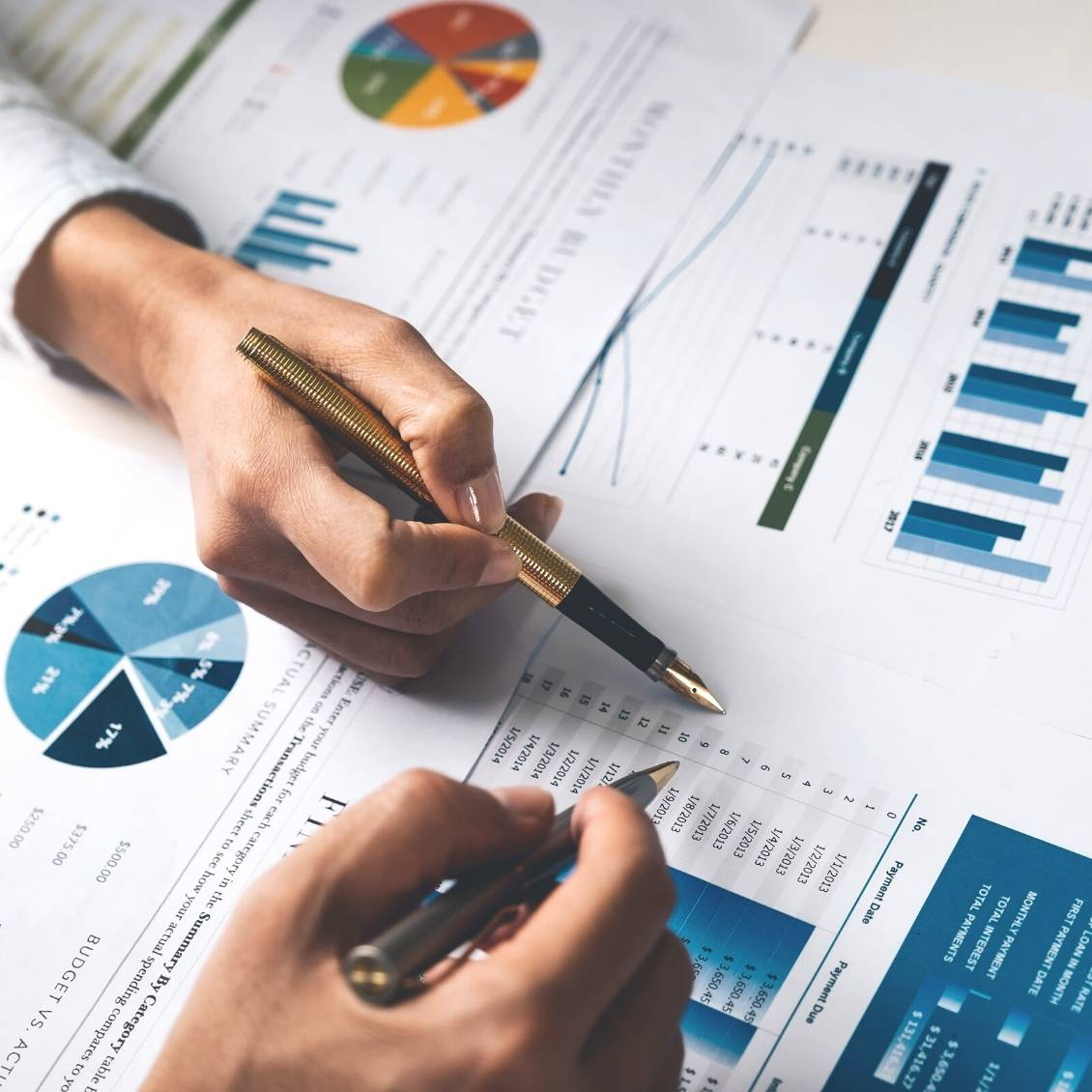 going over financial reports with Bookkeeping Enterprises